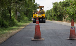 Heavy Vibration roller compactor at asphalt pavement works for road repairing Stock Images
