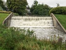Heavy water flow over the dam Royalty Free Stock Photos