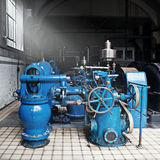 Heavy water pumping machinery. In vintage industrial water cleaning station Royalty Free Stock Photography