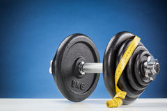 Heavy Weights with Tape Measure Stock Photography