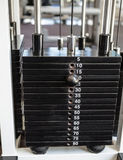 Heavy weights on the weight machine Stock Images