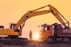 Heavy wheel excavator machine working Stock Photography