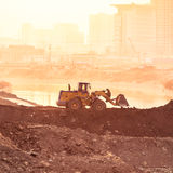 Heavy wheel excavator machine working at sunset Royalty Free Stock Images