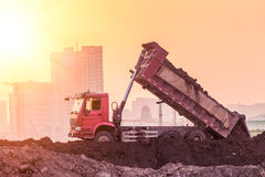 Heavy wheel loader machine working at sunset Stock Photography