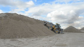 Heavy wheel loader working. At open sand pit quarry stock video