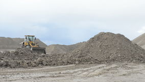 Heavy wheel loader working. At open sand pit quarry stock video footage