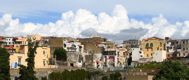Heavy white clouds rising above old town buildings. Many heavy white clouds on the background of the buildings from the Italian ancient town Herculaneum Royalty Free Stock Photo