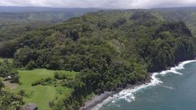 Heavy white rain cloud over deep green wild nature tropical forest Keanae coastline seascape Hawaii Maui 4k aerial drone. Heavy white rain cloud over deep green stock video footage
