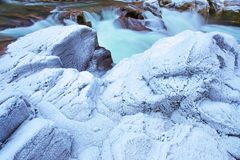 Heavy winter frost on creek-side rocks Royalty Free Stock Photography