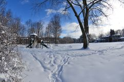 Winter urban city landscape - a snow-covered playground in a residential area in Canada. Heavy winter snow fall in Canada, a snow-covered playground in a royalty free stock photos