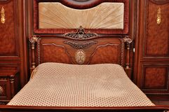 Heavy wood queen-size bed. With empty place royalty free stock photography
