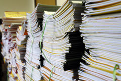 Heavy workload. An image of many stacks of work document waiting to be process stock image