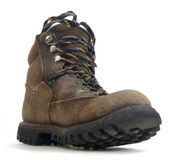 Heavy worn out hiking boot. With colorful laces on white background, low angle distorted perspective Stock Photos