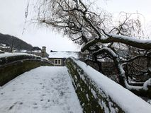 Hebden bridge with the old packhorse bride covered in snow. In winter Stock Photo