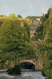 Hebden bridge town in summer with packhorse bridge crossing the river calder and stone buildings in summer with bright sky. Hebden bridge town in summer with Royalty Free Stock Image
