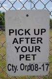 Heben Sie auf, nachdem Ihr Haustier herein Florida unterzeichnen stockfotografie