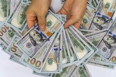 Heben Sie 100 US-Dollar auf Lizenzfreie Stockfotos
