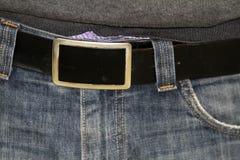Hebilla de correa de la manera en los pantalones vaqueros del dril de algodón Imágenes de archivo libres de regalías