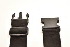Hebilla plástica negra en correa Foto de archivo libre de regalías