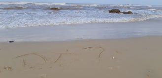 Hebrajszczyzn słowa na piasku obraz stock