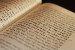 Hebrew Bible. Open to the middle with pages showing hebrew letters in the Torah which is also called the Pentateuch royalty free stock photography