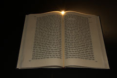 Hebrew Bible. Open to the middle with pages showing hebrew letters in the Torah which is also called the Pentateuch Royalty Free Stock Image