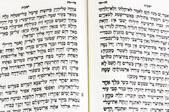 Hebrew Bible. The first page of Genesis in the Hebrew bible stock images