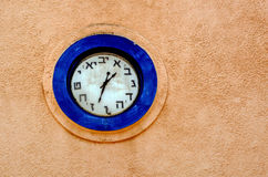 Hebrew clock. On a wall of a synagogue in Israel. copyspace stock photo