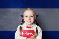 Hebrew concept with little girl student against the Israel flag. Background. Learn hebrew language stock images