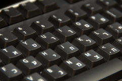 Hebrew/English Keyboard. Hebrew/English dual language black computer keyboard stock images