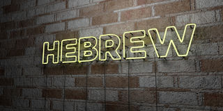 HEBREW - Glowing Neon Sign on stonework wall - 3D rendered royalty free stock illustration Royalty Free Stock Photo