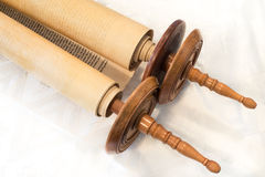 The Hebrew handwritten Torah scroll, on a synagogue alter Stock Photo