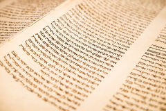 The Hebrew handwritten Torah scroll, on a synagogue alter Stock Image