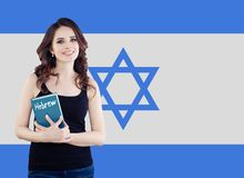 Hebrew language concept with happy woman student and the Israel flag.  royalty free stock photos
