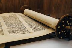 Hebrew religious handwritten Torah parchment scroll.  royalty free stock photo