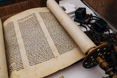 Hebrew religious handwritten Torah parchment scroll.  stock image