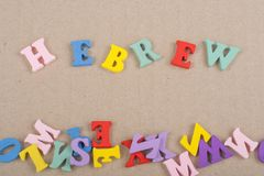 HEBREW word on paper background composed from colorful abc alphabet block wooden letters, copy space for ad text. Learning english concept stock photography