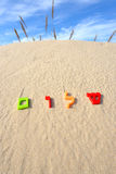Hebrew word shalom meaning peace. Plastic characters of Hebrew alphabet on a sand. Hebrew word Shalom meaning peace hello goodbye stock images