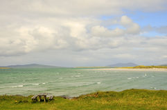 Hebridean View. View looking north-east across Traigh Lingeigh  from the machair at Shannda, west side of North Uist, Outer Hebrides, Scotland with the  hills of Stock Images