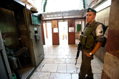 Hebron Checkpoint. HEBRON, OCCUPIED PALESTINIAN TERRITORIES - OCTOBER 17: An Israeli military checkpoint controls access to the Tomb of the Patriarchs aka the stock photos