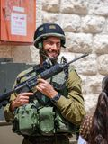 Undefined israeli soldier laughing. Hebron streets royalty free stock photography