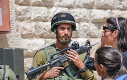 Undefined israeli soldier laughing. Hebron streets royalty free stock photos