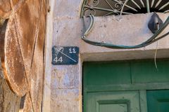Ancient plaque with house number on Hebron street royalty free stock photo