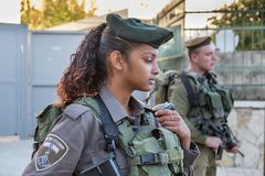 Undefined beautiful israeli girl soldier next to Cave of Machpelah in Hebron or Tomb of the Patriarchs. Israel. HEBRON, ISRAEL - NOVEMBER 02, 2018: Undefined stock photography