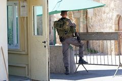 Hebron. Israeli soldier with assault rifle at the check point between jewish territory and palestinian territory in Hebron royalty free stock images