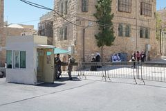 Hebron. Israeli soldiers stand guard at the checkpoint at the border between the israeli territory and palestinian territory in Hebron, Israel. The palestinian Stock Photo