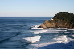 Heceta Head Lighthouse. A view across a small bay to the picturesque Heceta Head Lighthouse along the Oregon Coast on a clear winter day Royalty Free Stock Photo