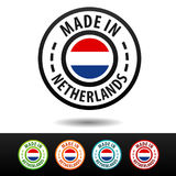 Hecho en insignias holandesas con la bandera de Netherland Imágenes de archivo libres de regalías