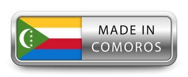 HECHO EN la insignia metálica de los COMORO con la bandera nacional aislada en el fondo blanco libre illustration