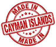 hecho en sello rojo del grunge de las Islas Caimán ilustración del vector